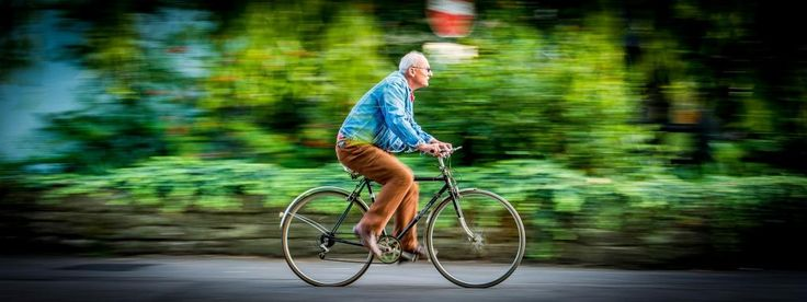 Man On Bicycle by Damien Harrow. A fantastic panning shot with motion blur to convey speed