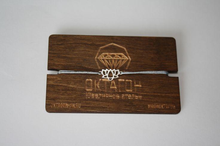 """Веревочный браслет с подвеской """"Лотос"""" из серебра 925 пробы."""