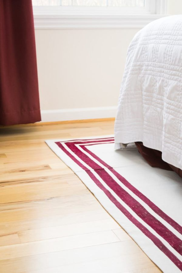 It's easy to make your own rug with just a drop cloth and fabric paint! Customize your rug to fit your decor.   drop cloth rug   how to make a rug   striped rug