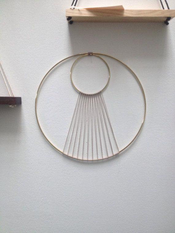Hand made hoop art piece wall hanging made from a polished brass ring and waxed hemp. Size: 14 diameter    Copyright 2011-2014 Sonadora. All