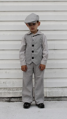 Newsboy cap, vest, and pants.