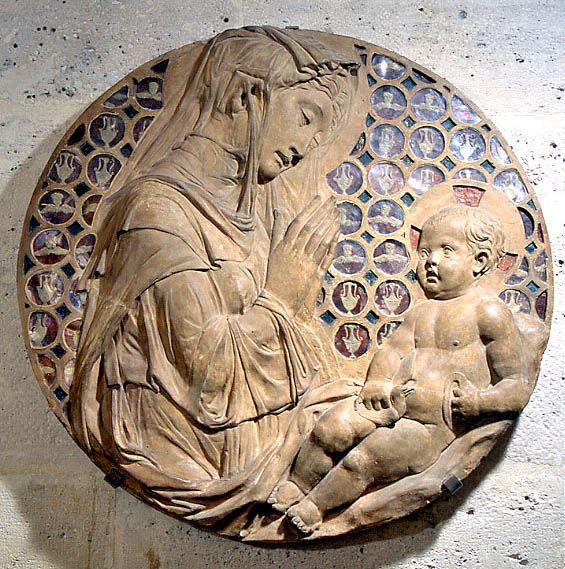 Donato di Niccolo BARDI dit DONATELLO Florence, vers 1386 - Florence, 1466  La Vierge adorant l'Enfant dite Madone Piot  Terre cuite avec traces de dorure, médaillons de cire sous verre H. : 0,74 m. ; P. : 0,07 m. Musée du Louvre