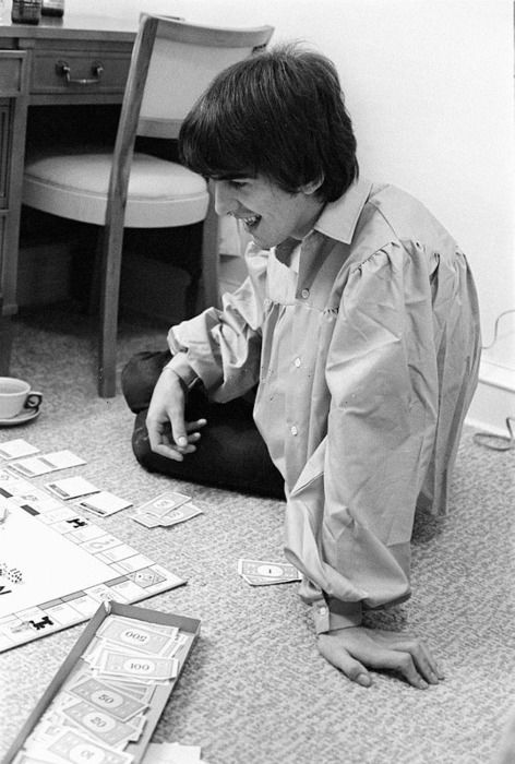 George playing Monopoly - a game he was rather fond of - in Bel Air during The Beatles' American Tour, September 1964.