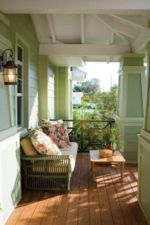 Traces of British colonial style can be seen in the wicker and rattan furniture painted the colors of the jungle and heaped with floral print cushions. Cottage Journal
