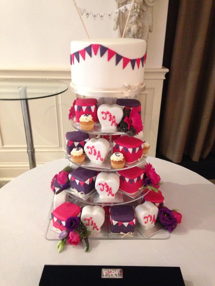 mini wedding cake towers beautiful pink and cadbury purple mini cake tower wedding 17437