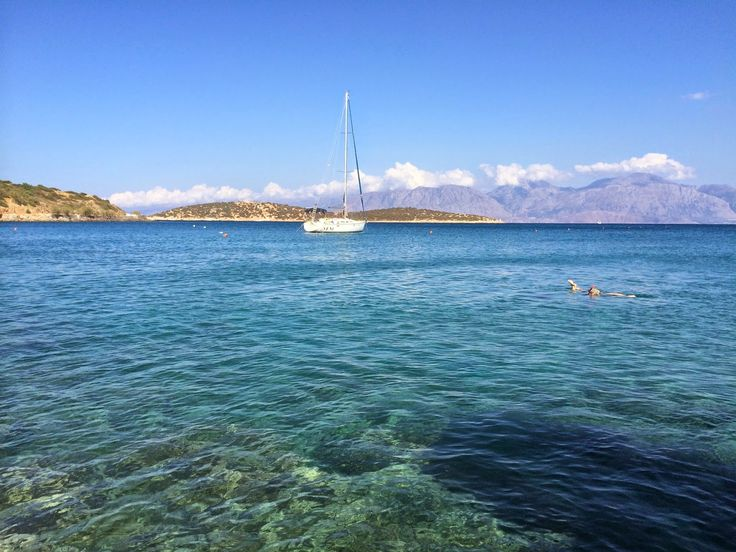 Snorkelling at the front of private beach of Minos Beach art hotel in Agios Nikolaos