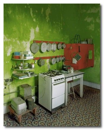 Kitchen in Cuba. This is a place of poverty and yet they have made it home-y and bright just with the color!