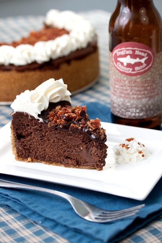 Incredible Bacon Chocolate Stout Cheesecake | If you love bacon and beer then this cheesecake is the perfect marriage of these two bold flavors.  A rich dark chocolate cheesecake is made with a stout, a dark beer with notes of chocolate and coffee, and topped with salty bacon bits.  This cheesecake is a great gameday dessert and will please just about anyone.