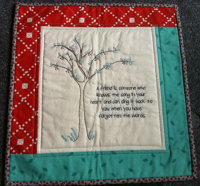 Love the idea of embroidery in center of small wall hanging - could play with quilting too!