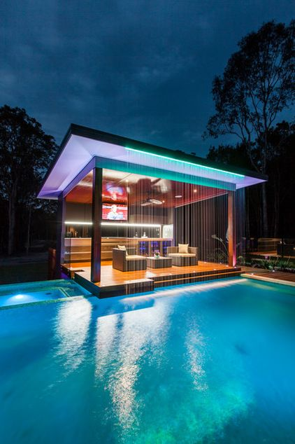 stunning pool bar in brisbane with custom waterfall with colored lighting used as gentle illumination