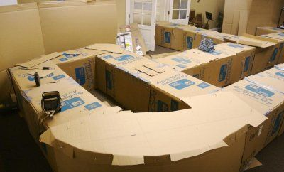 Cardboard box maze! This one spans two rooms and a hallway! Wish my parents would've done something like this for me as a kid!