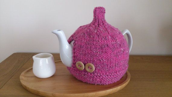 Pink hand knitted tea cosy with wooden button detail by DottyKnits