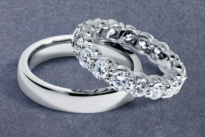 His and hers platinum wedding bands from @BlueNileDiamond.