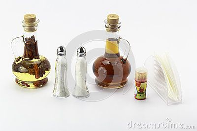 Oliviere with oil-pepper and vinegar and two salt and sugar on white background