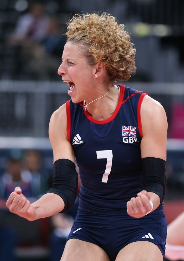 Day Three - JULY 30: Maria Bertelli of Great Britain celebrates winning a point in the Women's Volleyball Preliminary match between Great Britain and Algeria on Day 3 of the London 2012 Olympic Games at Earls Court on July 30, 2012 in London, England. (Photo by Elsa/Getty Images)