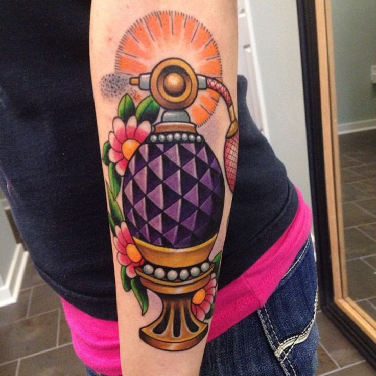 Neotraditional perfume atomizer by Les Collier at Searchlight Tattoo; Georgia.