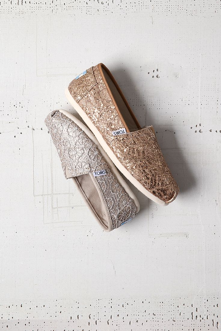 Complete your holiday party ensemble with vegan TOMS crochet sparkle slip-on shoes. Available in silver and rose gold for women and kids.