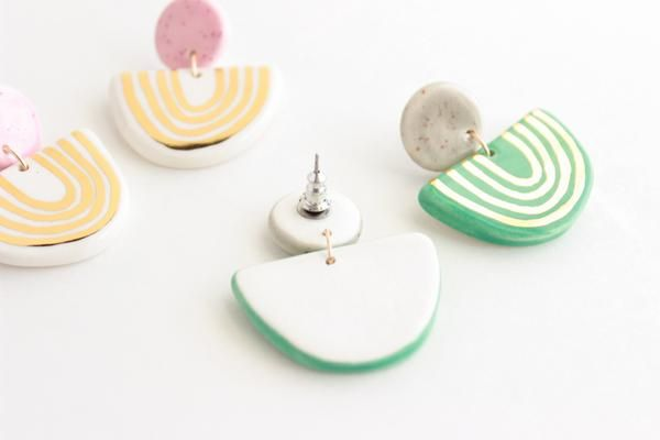 "These unique statement earrings will add a playful touch to any outfit and make your lobes feel fancy! They are hand cut from white earthenware, hand glazed, and accented with real 22k gold stripes.  + White earthenware, glaze+ 22k gold luster+ Approx. 1.5"" long x 1.25"" at widest point+ Securely affixed to nickel-free"