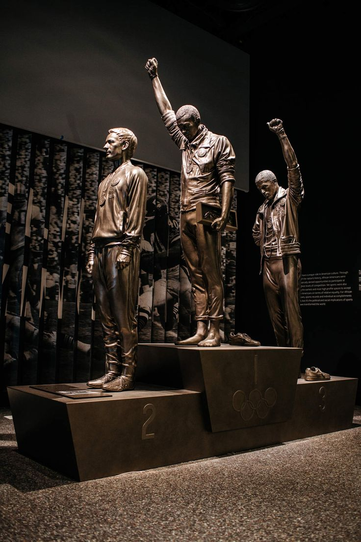 The National Museum of African American History and Culture - THE BLACK POWER SALUTE Tommie Smith and John Carlos raised black-gloved fists when the United States national anthem was played during their medal ceremony at the 1968 Olympics in Mexico City.