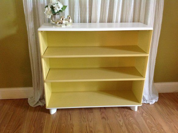 Yellow and white midcentury bookcase