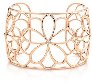 This cuff bracelet is made of lush 18 karat rose-colored gold, with a simple but elegant open-work flower …