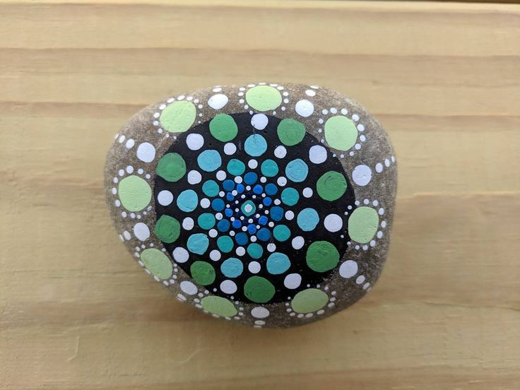 """Pax"" (2017) - dot mandala pattern on river rock. ""Pax"" means ""peace"" in Latin. . . . #art #artist #artshare #artofinstagram #artistsoninstagram #instaart #instaartist #craft #crafts #creative #creativelife #rock #stone #rockpainting #acrylic #handmade #original #mandala #meditation #zen #calm #hindi #buddhism #yoga #tiny #dots #point #dailyart #nofilter #j9creationstudio"