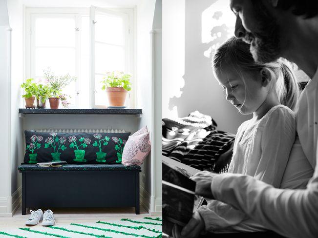 Zwarte opbergbank met zit- en rugkussen in zwart met groen bloemenmotief