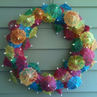 Wreath I made for a Hawaiian themed bridal shower. Just purchase  a foam wreath and stick drink umbrellas all over it. Aloha!