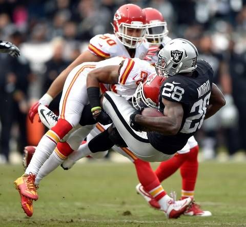 Kansas City Chiefs safety Eric Berry put a big hit on the Raiders' Latavius Murray during the first quarter on Sunday at O.co Coliseum in Oakland, Calif.