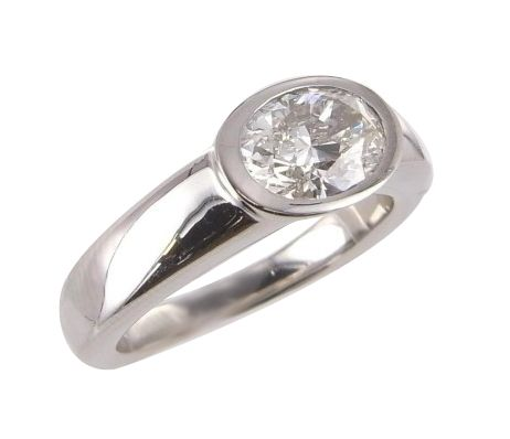 A rub over, oval set, diamond, engagement ring