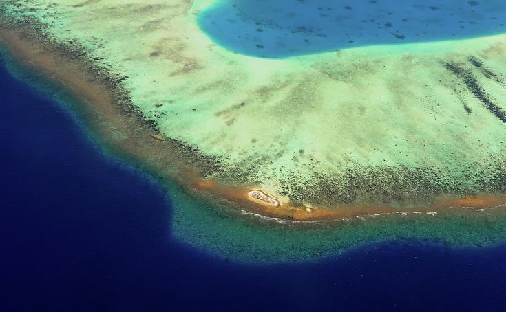 Aerial View Of Coral Reef Formation. Maldives by Jenny Rainbow
