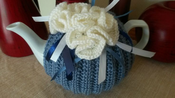 Light blue and white ribbons tea cosie