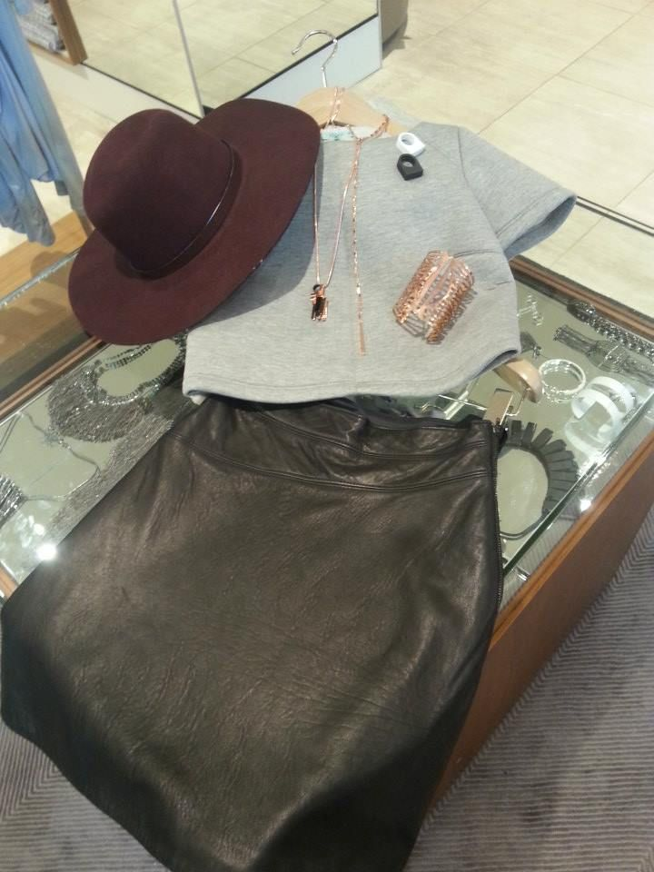 The leather skirt is great for added texture and is effortless to match with! Pair with rose gold jewellery, the burgundy floppy hat and a thick grey crop!