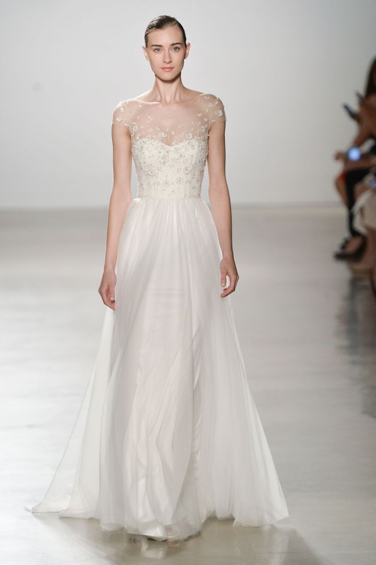 From plunging V-necks to feathery skirts and floral embellishments, these are a few of our favourite trends from the Bridal spring '16 runway.