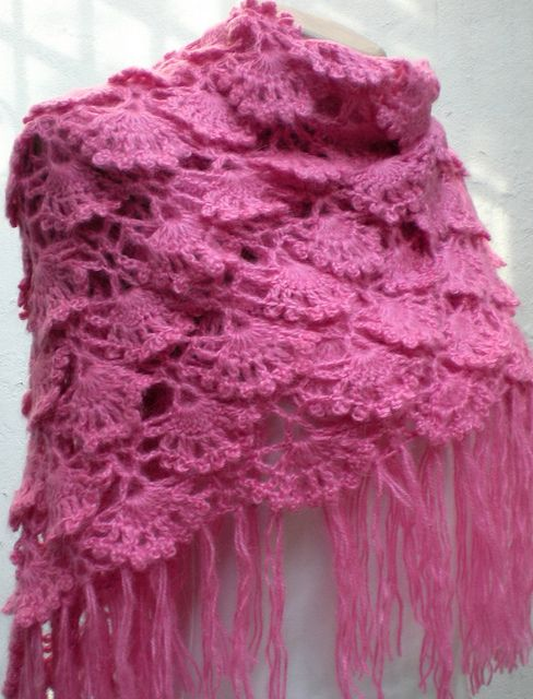 Check out the Flickr stream. She makes beautiful shawls and scarves, among many other things.