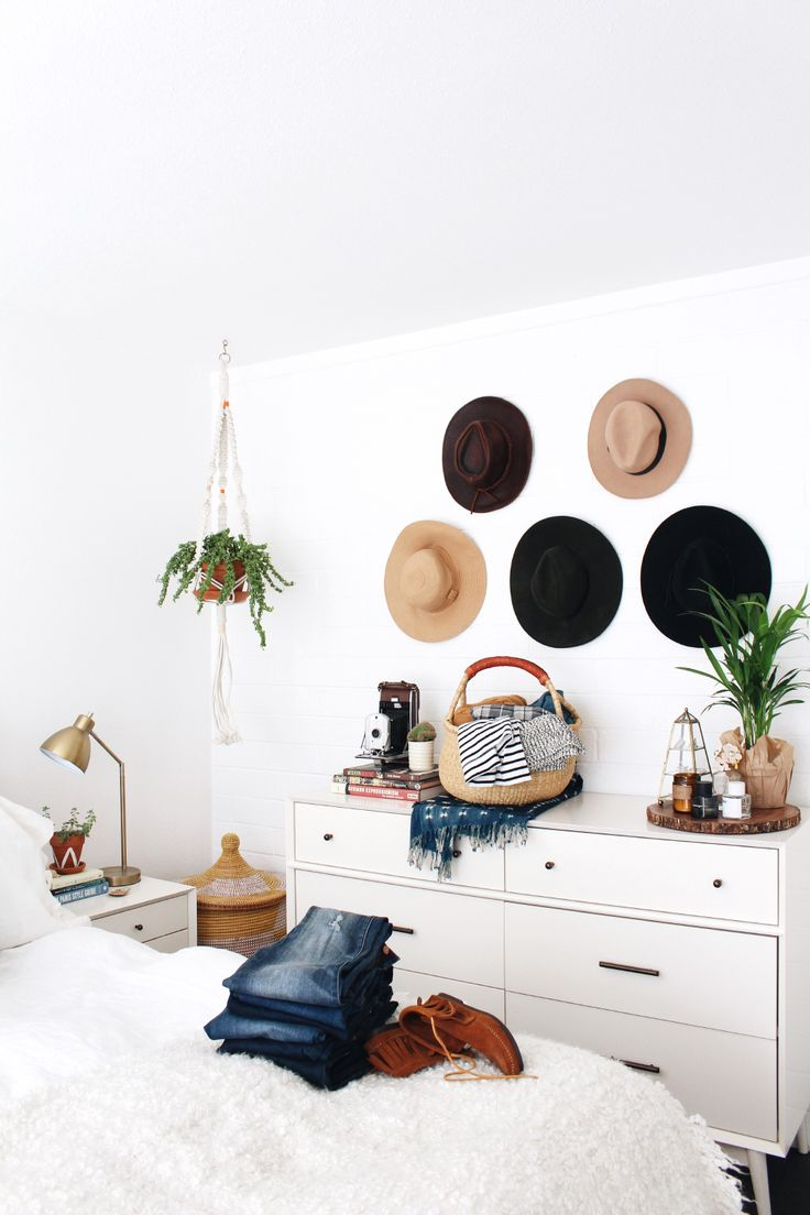 At Home with New Darlings // white and wood bedroom decor // vintage hats as wall decor above dresser
