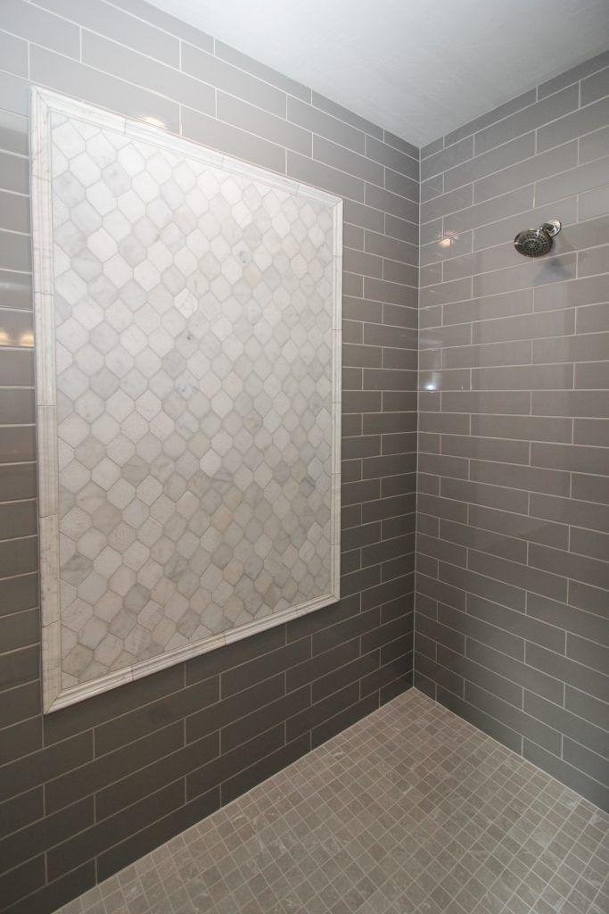gray tiled shower with light gray tile