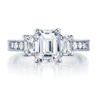 Three stone emerald cut diamond engagement ring with channel set band featuring milgrain engraving detail. Ingwer at George Simons & Son. #engagement #ring #diamond