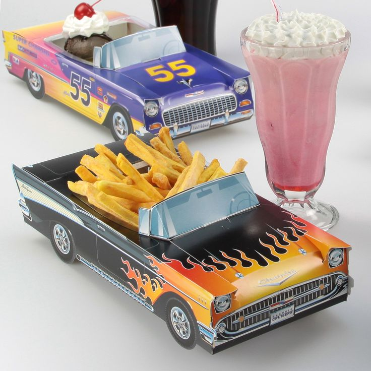 Made of thick paperboard, this Classic Cruisers car carton is the perfect centerpiece for a 1950s theme party. This paper replica of a vintage black Chevrolet folds together and can be used as a candy goodie basket or retro table decoration. Great for kids birthdays, reunions and anniversary parties. Available plastic inserts turn it into the coolest food tray around. Affordable and fun. Officially licensed. Measures 11