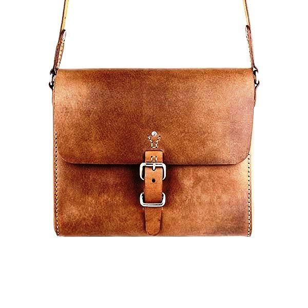 The companion satchel in vintage brown She is compact and light-weight but still with plenty of room for the essentials. This timeless design crosses through all seasons, making her the perfect complement to any ensemble, year after year. Durability to explore the globe with you. Cute enough to take out to dinner with you. This girl is ready to join you for any adventure.