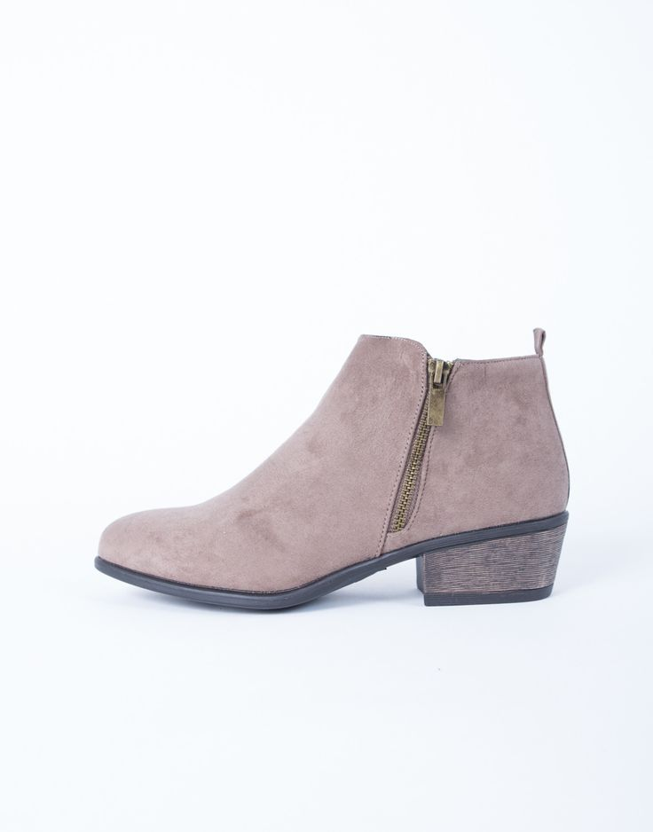 You need a pair of boots that can be easily dressed up or down for whatever the occasion? These Casual Suede Booties will do the trick. Comes in black and taupe. Made from a faux suede material. Featu