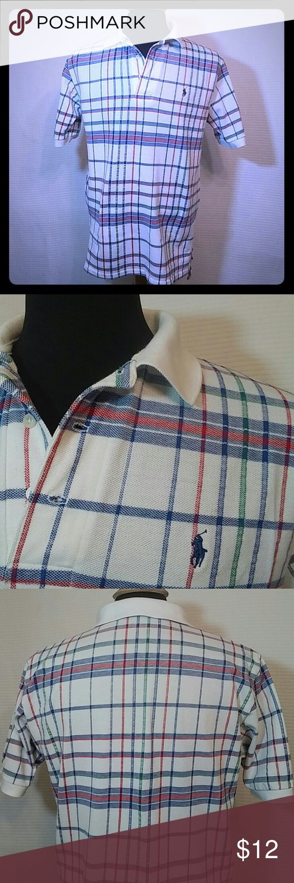 Polo by Ralph Lauren  shirt. It's a man's (Ralph Lauren Polo Shirt) Multi-color checkered shirt. Size-M in great condition. Ralph Lauren Shirts Polos