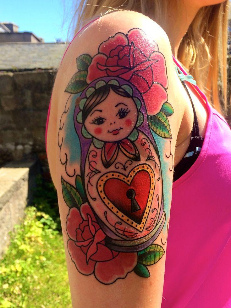 Colourful Russian doll tattoo.                                                                                                                                                                                 Mais