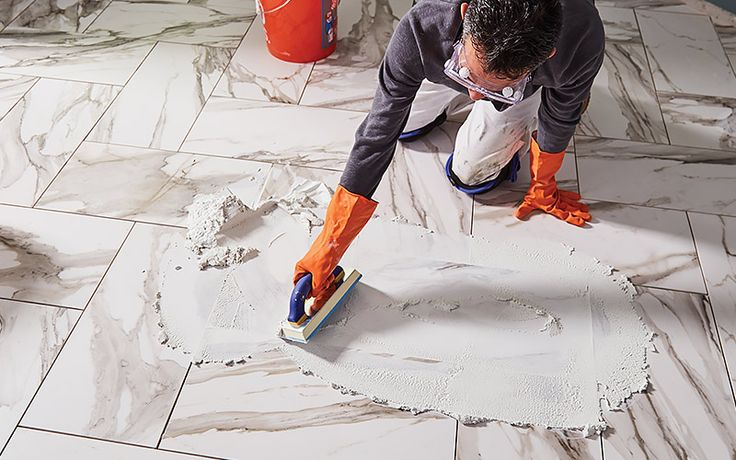 A Person Using A Grout Float To Apply Grout To Tile In 2020 Ceramic Floor Tile Ceramic Floor Diy Floor Installation
