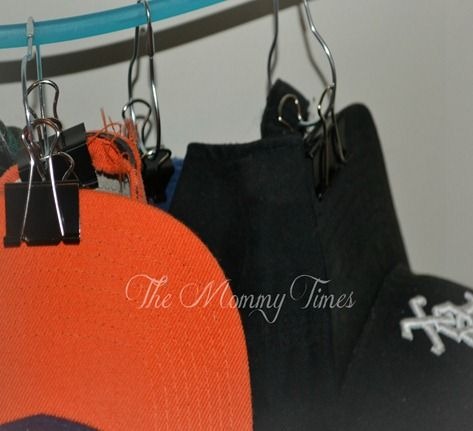 Easy, cheap hat/cap organizer.  Hanger, shower curtain and clips easily hang your hats!