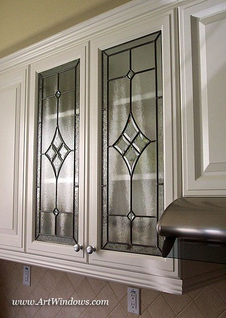 The 25 best glass cabinets ideas on pinterest glass for Beveled glass kitchen cabinets