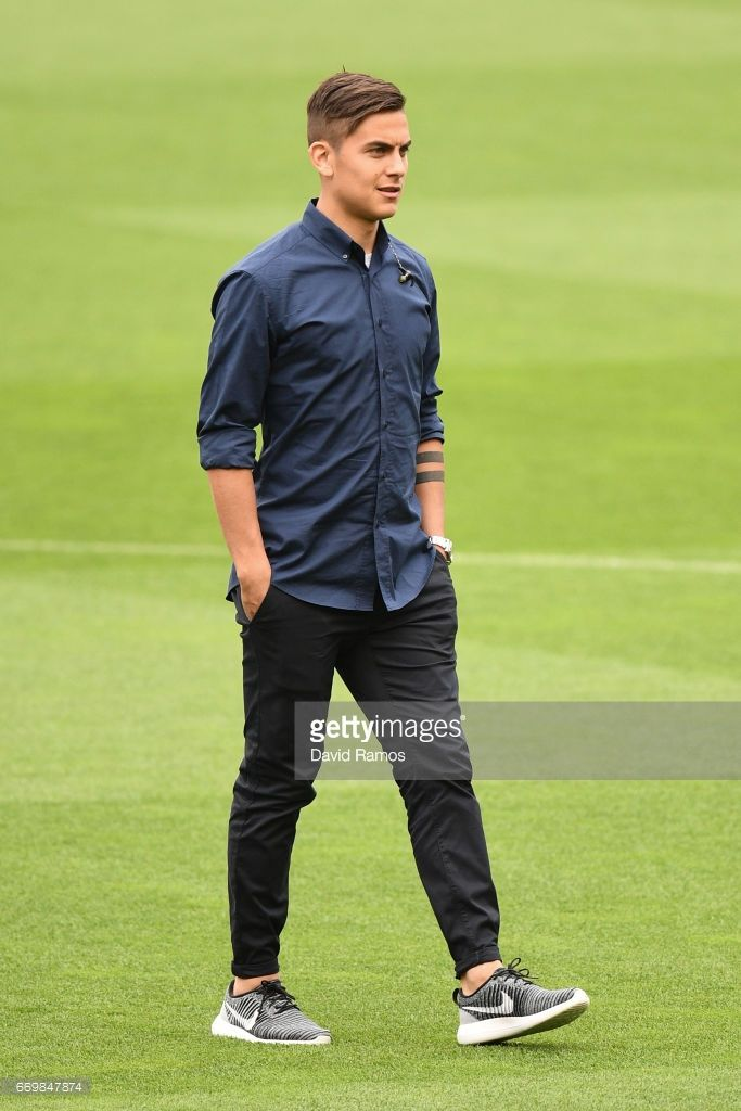 Paulo Dybala of Juventus walks on the pitch prior to the Juventus press conference at the Camp Nou on April 18, 2017 in Barcelona, Spain.