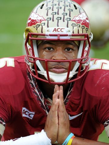 Florida State Seminoles quarterback Jameis Winston (5) warms up before the start of the game against the Syracuse Orange at Doak Campbell Stadium.