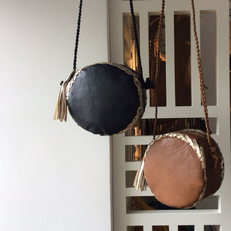 Tambourlo bags in brown-gold and black-gold travel to Hong Kong