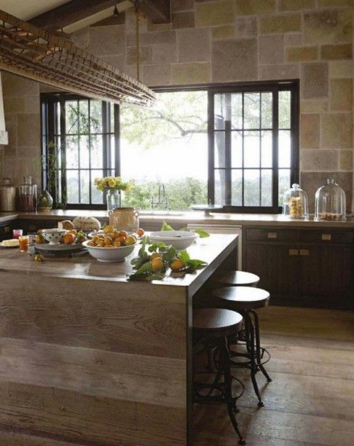 Wooden countertop wrap down, long suspended basket above island, tiled wall, black window frame. - romantic mood.